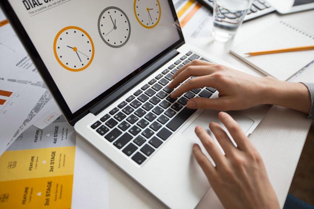 hands-businesswoman-using-laptop-office